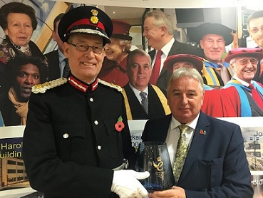 AvSax managing director Richard Bailey pictured receiving his Queen's Award for Enterprise from the Lord Lieutenant of West Yorkshire, Ed Anderson.